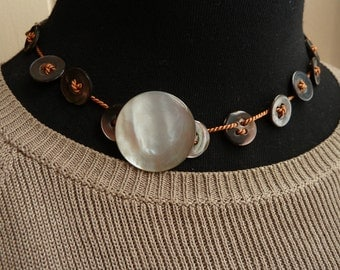 Burnt Orange colored choker with vintage abalone buttons