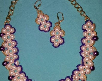 Sew on handmade necklace and earrings.