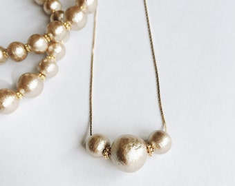 gold cotton pearl necklace