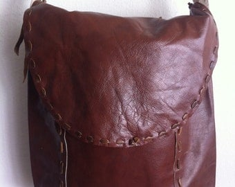 New brown big crossbody bag on a long strap, a bag made of genuine leather.