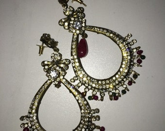 Ruby and emerald color earrings