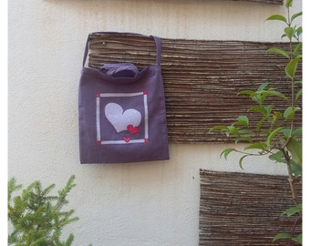 Lila heart bag.