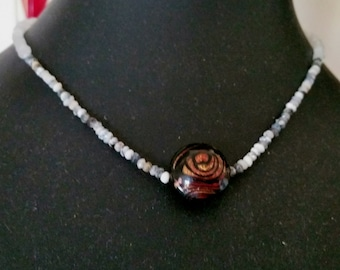 A simple elegant piece, which consist of beautiful moonstone,dendrite opal roundelles. A murano glass bead in centre.
