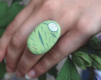 Ring matryoshka. Green fish.