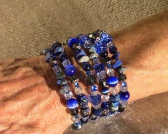 Six strand coil bracelet
