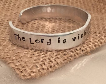 "Warrior Scripture cuff bracelet Judges 6:12 ""The Lord is with you, mighty warrior."" Silver-toned 12 gauge aluminum hypoallergenic 6"" x 3/8"""