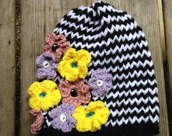 black and white striped hat with lavender purple, yellow and dusty rose pink flowers