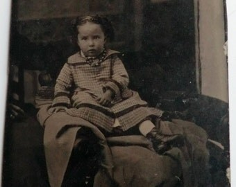 Tintype Photo Little Girl Wearing Beads Checked Dress Hand of Mother on Left of Photo
