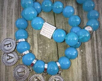 Glass bracelets with charms