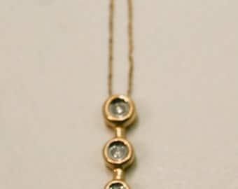 Three diamond yellow gold necklace