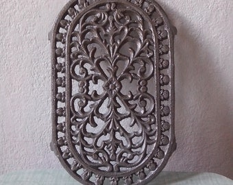 Brand new cast iron trivet