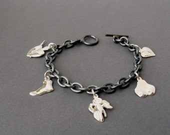 Bracelets made of silver with charms, blackened silver bracelet with Milagro - pendants, silver bracelet with charms
