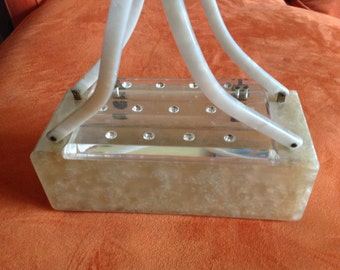 Vintage pearlized cream colored lucite purse with rhinestone decorated top