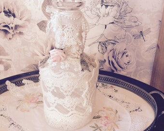 Vintage decanter decorated with old lace and accessories
