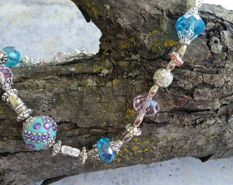 Beaded necklace with aqua and pink beads and silver accents