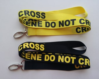2 Crime Scene Do Not Cross lanyards/keychains