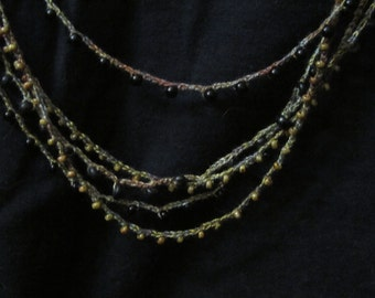 Crocheted necklace with beads Black browns beige