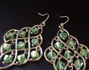 Green jeweled earrings