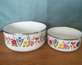 Two floral enamel mixing bowls