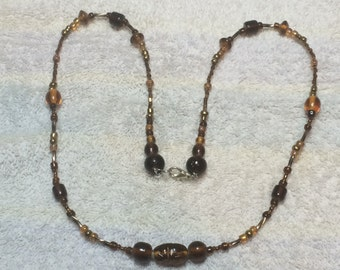 Brown and Copper Glass-beaded Necklace, 24 1/2 inches long, stainless steel wire