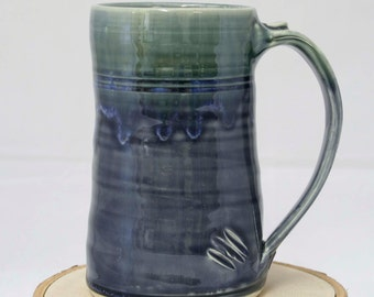 Made to order, Ergonomic handmade in the USA clay coffee/tea/beer mug. food, dishwasher, and microwave safe.
