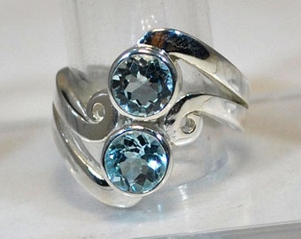 Sterling silver ring with blue topaz settings
