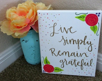 "Canvas ""live simply remain grateful"""