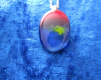 A small fused glass pendant