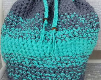 Charcoal grey and bright turquoise ombre backpack