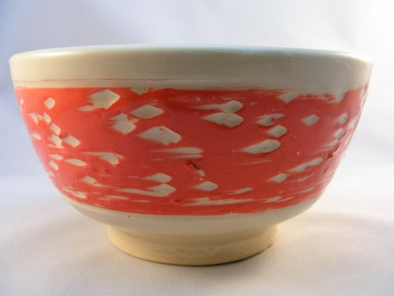 Coral and white bowl with floral design
