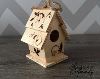 Wood burned bird feeder