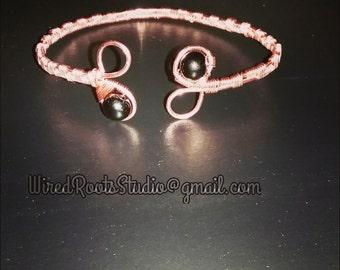 Natural raw copper bracelet with basket weave style, adorned with 8mm black jasper.