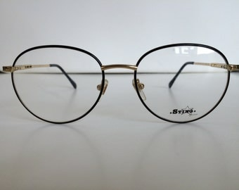 Sting Semi Round Frame in Black with Champagne Gold