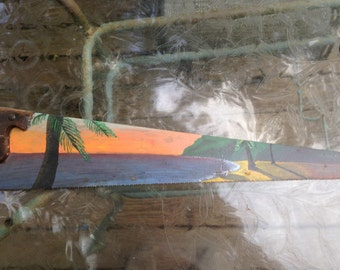 Painted saw; tropical sunset