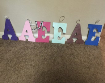 Decorative painted letters with added ribbon/twine or rope for hanging