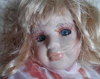 Porcelain doll in Pink Dress