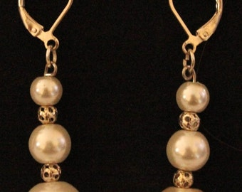 White glass pearl and silver earrings