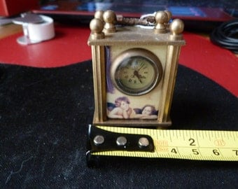 small mechanical wind up carriage clock