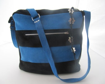 Black and blue soft suede handbag