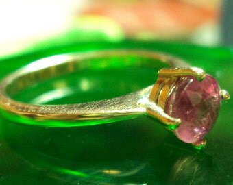 Golden ring with ruby
