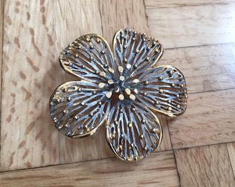 Gold plated flower broach.