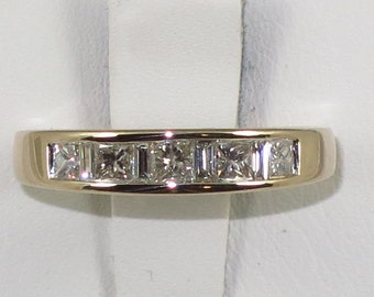 Estate 14 k yellow gold band with 0.70ct, SI1-F color princess and baguett Diamond, size 6.5