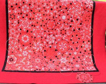 Orange kaleidoscope twin bed quilt