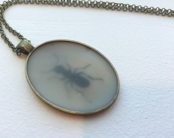 """Industrious little ant pendant on a chain. Original, encaustic beeswax necklace on a 24"""" chain."""