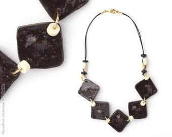 Square black and white collar