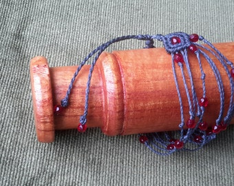 Bracelet dark blue and red beads