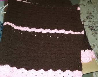 Brown and pink single bed sized afghan