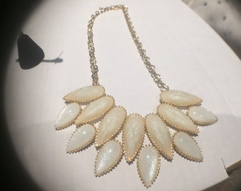 white necklace and earrings
