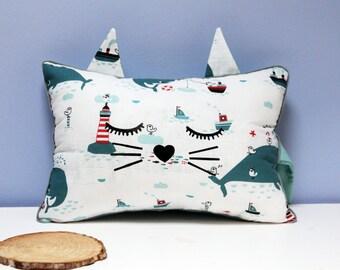 Cushion kitten sleeps