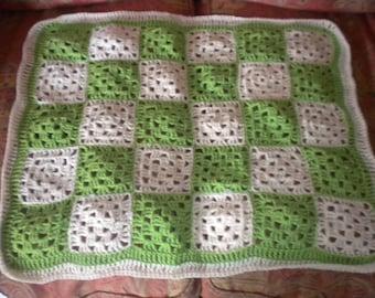 Green and oatmeal crochet baby blanket